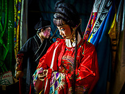 26 AUGUST 2018 - GEORGE TOWN, PENANG, MALAYSIA: A woman gets into her costume before a Hokkien style Chinese opera on the Lim Jetty in George Town for the Hungry Ghost Festival. The opera troupe came to George Town from Fujian province in China. The Hungry Ghost Festival is a traditional Buddhist and Taoist festival held in Chinese communities throughout Asia. The Ghost Festival, also called Ghost Day, is on the 15th night of the seventh month (25 August in 2018). During the Hungry Ghost Festival, the deceased are believed to visit the living. In many Chinese communities, there are Chinese operas and puppet shows and elaborate banquets are staged to appease the ghosts.    PHOTO BY JACK KURTZ