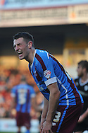 Murray Wallace of Scunthorpe United gives away penalty during the Sky Bet League 1 match between Scunthorpe United and Barnsley at Glanford Park, Scunthorpe, England on 31 October 2015. Photo by Ian Lyall.