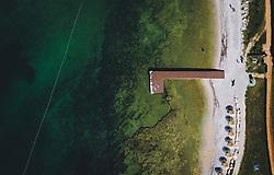 THEMENBILD - Urlauber sonnen sich auf einem Steg an der Küste der Adria, aufgenommen am 05. Juli 2020 in Novigrad, Kroatien // Holidaymakers sunbathe on a jetty on the Adriatic coast in Novigrad, Croatia on 2020/07/05. EXPA Pictures © 2020, PhotoCredit: EXPA/ JFK