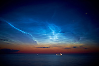 Ship Passing Under Electric Noctilucent Clouds on the Baltic Sea from the Deck of the MV/Explorer. Image taken 2 months ago today with a Fuji X-T1 camera and 23 mm f/1.4 lens (ISO 200, 23 mm, f/1.4, 1 sec). Raw image processed with Capture One Pro, Nik Define, and Photoshop CC 2014.