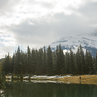 Early snowfall dusts the Canadian Rockies, reflected in the Cascade Ponds in Alberta's Banff National Park.