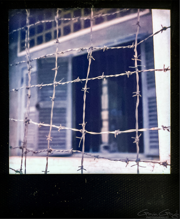 Barbed wire outside a cell block, Tuol Sleng S-21 Genocide Museum, Cambodia