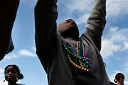 New Orleans, Louisiana. United States. February 28th 2006..Kids ask for beads and presents at the Zulu Parade on Saint Charles Avenue.