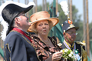 Belgian Crown Prince Filip and Dutch Queen Beatrix attend the 100 years' jubilee of the Old Limburgs Citizens Soldiers in Stramproy, in southern Netherlands near the Belgian border.<br /> <br /> Hare Majesteit de Koningin en Zijne Koninklijke Hoogheid Prins Filip van België bezoeken het 100-jarig jubileum van  het Oud Limburgs Schuttersfeest in Stramproy. Honderd jaar geleden vond voor het eerst een schuttersevenement plaats onder de naam Oud Limburgs Schuttersfeest. Het is een jaarlijks evenement waaraan ruim 160 schutterijen uit zowel Nederlands als Belgisch Limburg deelnemen. <br /> <br /> On the photo / Op de foto: <br /> <br />  A Member or the Citzen Solders explain Queen Beatrix serval things / Een Gilde lid legt Beatrix een en ander uit.