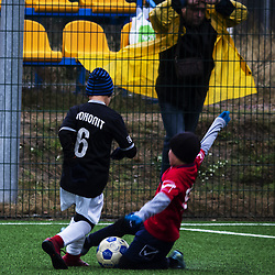 September 29, 2018 - Zazymie, Kiev, Ukraine - Mnolit-2 kid seen scoring during the game..Soccer championship among schoolchildren there was a football match between the teams of the Sports Club Boryspil Sport (red) and Mnolit-2, the game ended in a draw. (Credit Image: © Igor Golovniov/SOPA Images via ZUMA Wire)