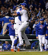 CHICAGO, IL - OCTOBER 12:  Hector Rondon #56 and Miguel Montero #47 of the Chicago Cubs celebrate after Game 3 of the NLDS against the St. Louis Cardinals at Wrigley Field on Monday, October 12, 2015 in Chicago , Illinois. (Photo by Ron Vesely/MLB Photos via Getty Images) *** Local Caption *** Hector Rondon; Miguel Montero