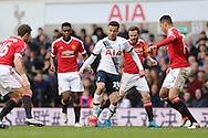 Dele Alli of Tottenham Hotspur with the ball while being marked by Juan Mata of Manchester United, Chris Smalling of Manchester United and Michael Carrick of Manchester United.Barclays Premier league match, Tottenham Hotspur v Manchester Utd at White Hart Lane in London on Sunday 10th April 2016.<br /> pic by John Patrick Fletcher, Andrew Orchard sports photography.