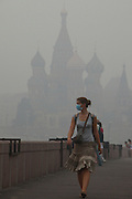 Moscow, Russia, 06/08/2010. .People crossing a bridge from Red Square wear protective masks against the intense smog that has permeated every part of he city in the record high temperatures of the continuing heatwave. Peat and forest fires in the countryside surrounding Moscow have resulted in the Russian capital being blanketed in heavy smog.