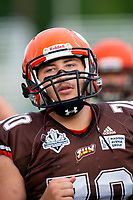 KELOWNA, BC - AUGUST 17:  Lucas Spencer #70 of Okanagan Sun runs off the field against the Westshore Rebels  at the Apple Bowl on August 17, 2019 in Kelowna, Canada. (Photo by Marissa Baecker/Shoot the Breeze)