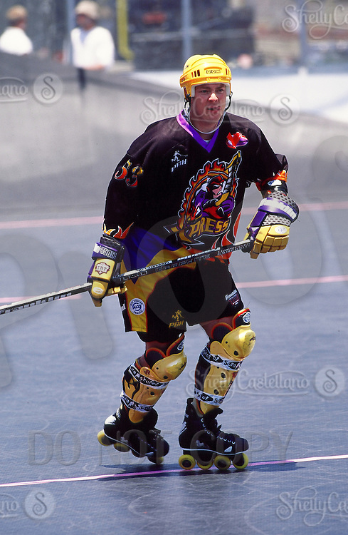 1999: Roller hockey player on team Express Mike Doers in action during Pro Beach Hockey PBH game in Huntington Beach.   Southern California summer sport. Transparency slide scan.