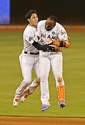 June 19, 2017 - Miami, FL, USA - Miami Marlins' Christian Yelich celebrates with Marcell Ozuna, who hit a game-winning RBI, scoring Dee Gordon in the bottom of the ninth inning against the Washington Nationals on Monday, June 19, 2017 in Miami, Fla. (Credit Image: © Patrick Farrell/TNS via ZUMA Wire)