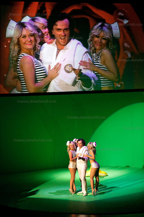 Picture shows : Thomas Walker as Lindoro with the bunny girls..Picture  ©  Drew Farrell Tel : 07721 -735041..A new Scottish Opera production of  Rossini's 'The Italian Girl in Algiers' opens at The Theatre Royal Glasgow on Wednesday 21st October 2009..(Soap) opera as you've never seen it before..Tonight on Algiers.....Colin McColl's cheeky take on Rossini's comic opera is a riot of bunny girls, beach balls, and small screen heroes with big screen egos. Set in a TV studio during the filming of popular Latino soap, Algiers, the show pits Rossini's typically playful and lyrical music against the shoreline shenanigans of cast and crew. You'd think the scandal would be confined to the outrageous storylines, but there's as much action off set as there is on.....Italian bass Tiziano Bracci makes his UK debut in the role of Mustafa. Scottish mezzo-soprano Karen Cargill, who the Guardian called a 'bright star' for her performance as Rosina in Scottish Opera's 2007 production of The Barber of Seville, sings Isabella..Cast .Mustafa...Tiziano Bracci.Isabella..Karen Cargill.Lindoro...Thomas Walker.Elvira...Mary O'Sullivan.Zulma...Julia Riley.Haly...Paul Carey Jones.Taddeo...Adrian Powter..Conductors.Wyn Davies.Derek Clarke (Nov 14)..Director by Colin McColl.Set and Lighting Designer by Tony Rabbit.Costume Designer by Nic Smillie..New co-production with New Zealand Opera.Production supported by.The Scottish Opera Syndicate.Sung in Italian with English supertitles..Performances.Theatre Royal, Glasgow - October 21, 25,29,31..Eden Court, Inverness - November 7. .His Majesty's Theatre, Aberdeen  - November 14..Festival Theatre,Edinburgh - November 21, 25, 27 ...Note to Editors:  This image is free to be used editorially in the promotion of Scottish Opera. Without prejudice ALL other licences without prior consent will be deemed a breach of copyright under the 1988. Copyright Design and Patents Act  and will be subject to payment or legal action, where appropriate..Further further