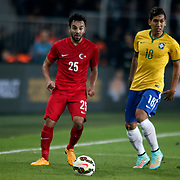 Turkey's Volkan Sen (L) and Brazil's Roberto Firmino (R) during their a international friendly soccer match Turkey betwen Brazil at Sukru Saracoglu Arena in istanbul November 12, 2014. Photo by Aykut AKICI/TURKPIX