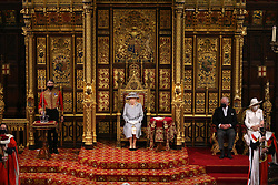 Queen Elizabeth II with the Prince of Wales and the Duchess of Cornwall seated next to her as she delivers a speech from the throne in House of Lords at the Palace of Westminster in London as she outlines the government's legislative programme for the coming session during the State Opening of Parliament. Picture date: Tuesday May 11, 2021.