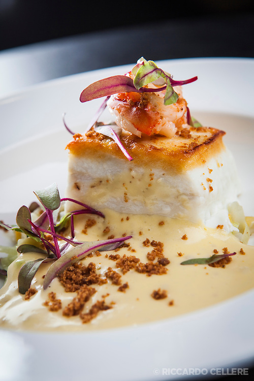 Visa Infinite Wine Country Experiences Exclusive Dinner at Stratus Vineyard with Chef David Hawksworth, and Master Sommelier John Szabo. Pacific Halibut, butter poached lobster, sweet corn, fennel, brown butter emulsion.
