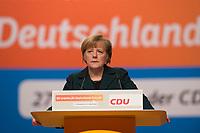 09 DEC 2014, KOELN/GERMANY:<br /> Angela Merkel, CDU, Bundeskanzlerin, haelt ihre Rede als Parteivorsitzende der CDU, CDU Bundesparteitag, Messe Koeln<br /> IMAGE: 20141209-01-030<br /> KEYWORDS: Party Congress