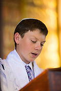 Bayne Albin rehearses his Bar Mitzvah at Temple Beth Abraham in Oakland, California, on April 30, 2014. (Stan Olszewski/SOSKIphoto)