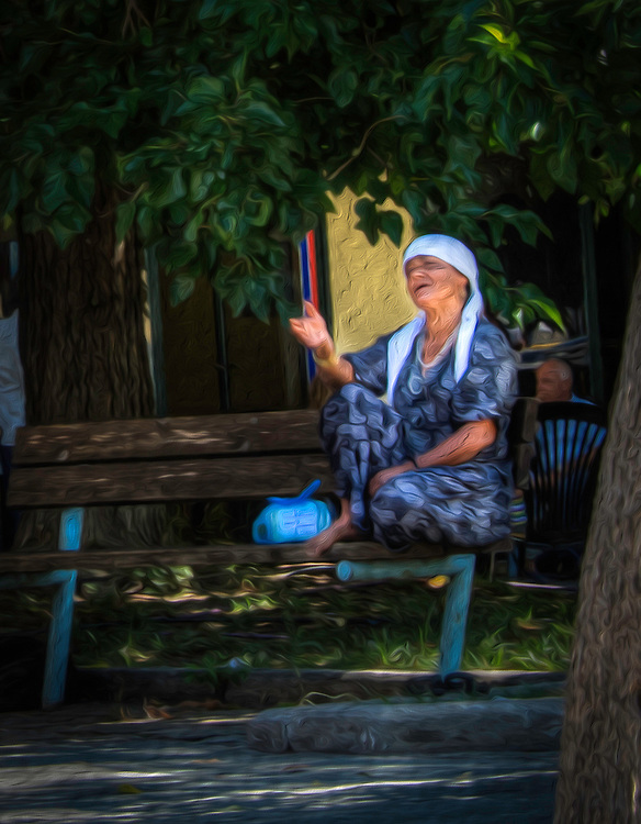 Gypsy woman on park bench
