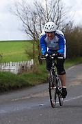 United Kingdom, Finchingfield, Mar 27, 2010:  Paul Dewberry, VC Revolution, approaches the 4 miles to go marker during the 2010 edition of the 'Jim Perrin' Memorial Hardriders 25.5 mile Sporting TT promoted by Chelmer Cycling Club. Copyright 2010 Peter Horrell.