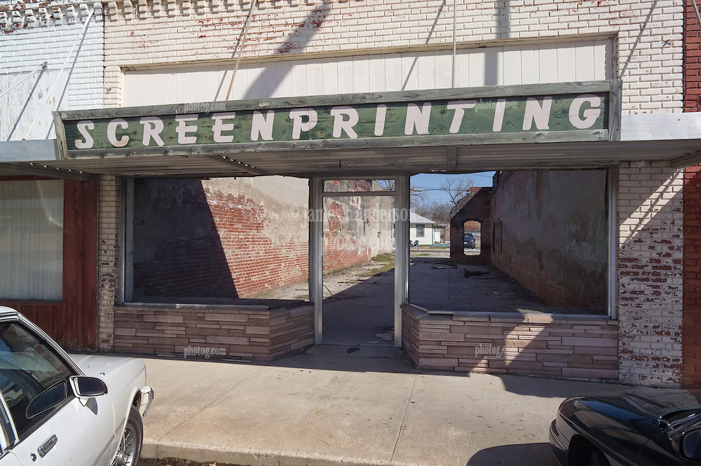 """""""Screen Printing"""" a Rundown Building in Downtown Commerce Oklahoma. You can see through to the next block."""
