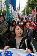 Tomoko Horanuchi, a student activist with Zengakren (All Japan Federation of Students' Autonomous Body),  leads a protest march at a demo outside Hosei university, Ichigaya, Tokyo, Japan Friday April 23rd 2010