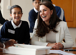 The Duchess of Cambridge talks to children as she attends a lesson which focused on plastic in the sea at the 1851 Trust charity's final Land Rover BAR Roadshow at Docklands Sailing and Watersports Centre in London.