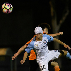 BRISBANE, AUSTRALIA - DECEMBER 22: Joe Caletti of the Roar and Gerrie Sylaidos of Melbourne City compete for the ball during the round 4 Foxtel National Youth League match between the Brisbane Roar and Melbourne City at AJ Kelly Field on December 22, 2016 in Brisbane, Australia. (Photo by Patrick Kearney/Brisbane Roar)