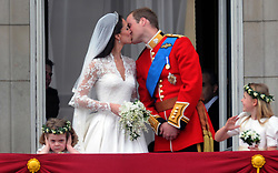 Prince William and his bride Catherine Middleton kiss on the balcony of Buckingham Palace following their wedding on April 29, 2011.