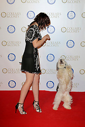 © Licensed to London News Pictures. 07/11/2013. Ashleigh & Pudsey at the Battersea Dogs & Cats Home Collars & Coats Gala Ball at Battersea Evolution, London UK. Photo credit: by Richard Goldschmidt/LNP