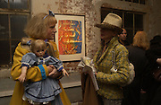 Grayson Perry and Bettina Schroder. AMNESTY INTERNATIONAL EXHIBITION 'IMAGINE A WORLDƒ  WITHOUT VIOLENCE AGAINST WOMEN' Bargehouse Gallery. Oxo Tower. <br />24 November 2005. ONE TIME USE ONLY - DO NOT ARCHIVE  © Copyright Photograph by Dafydd Jones 66 Stockwell Park Rd. London SW9 0DA Tel 020 7733 0108 www.dafjones.com