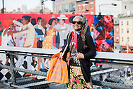Faith Ringgold, in front of her piece 'Groovin High' High Line Art Commission