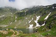 Balea Lac Chalet over Balea glacier Lake next to Transfagarasan Road in Fagaras Mountains, Romania