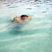 Bruce surfaces from the cyrstal-clear water in Lake McKenzie on Fraser Island.