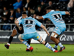 Keelan Giles of Ospreys under pressure from Scott Cummings of Glasgow Warriors<br /> <br /> 2nd November, Liberty Stadium , Swansea, Wales ; Guinness pro 14's Ospreys Rugby v Glasgow Warriors ;  <br /> <br /> Credit: Simon King/News Images<br /> <br /> Photographer Simon King/Replay Images<br /> <br /> Guinness PRO14 Round 8 - Ospreys v Glasgow Warriors - Friday 2nd November 2018 - Liberty Stadium - Swansea<br /> <br /> World Copyright © Replay Images . All rights reserved. info@replayimages.co.uk - http://replayimages.co.uk