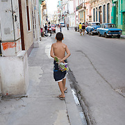 """Young boy in Havana, Cuba taking flowers to his mother.<br /> <br /> *For all details about sizes, paper and pricing starting at $85, click """"Add to Cart"""" below."""