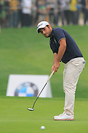 Alexander Levy (FRA) putts on the 17th green during Saturay's Round 3 of the 2014 BMW Masters held at Lake Malaren, Shanghai, China. 1st November 2014.<br /> Picture: Eoin Clarke www.golffile.ie