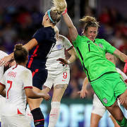 United States goalkeeper Alyssa Naeher (1) punches the ball away during the first match of the 2020 She Believes Cup soccer tournament at Exploria Stadium on 5 March 2020 in Orlando, Florida USA.