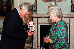File photo dated 16/10/98 of Poet Laureate Ted Hughes and Queen Elizabeth II. The Duke and Duchess of Sussex are preparing for the christening of their son Archie, which will take place on Saturday.