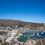 Santa Catalina Island is located 26 miles of the California coast from Los Angeles and is a part of Los Angeles County. The island's history is as a playground for the rich and famous going back to the early 1900s. Avalon serves as a destination for tourists from around the world who sun bathe and shop the quaint streets filled with local artisans, restaurants and bars.