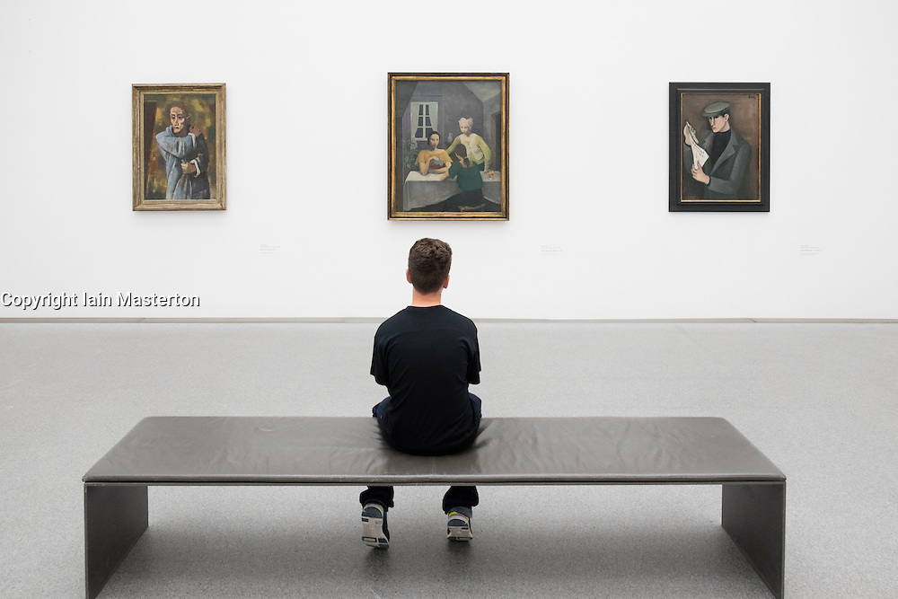 Boy looking at paintings at Pinakothek Museum in Munich Germany