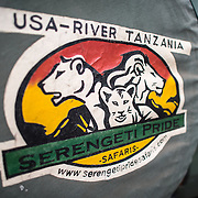 The logo of Serengeti Pride, a travel and guide company for Mt Kilimanjaro. The shot is of the tire cover on the back of one of their Toyota Landcruisers.