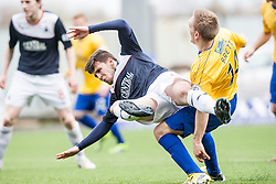 Falkirk's Lewis Small tackled by Cowdenbeath's Dean Brett.<br /> half time : Falkirk v Cowdenbeath, Scottish Championship game played today at The Falkirk Stadium.<br /> © Michael Schofield.