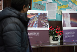 8 December 2019, Madrid, Spain: Dinesh Suna looks at the exhibition 'And It Is Good' in the Iglesia de Jesús in central Madrid, as Christians from around the globe have gathered with local congregants to celebrate an ecumenical prayer service during COP25.
