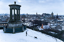 Edinburgh, Scotland, UK. 29 December 2020. Edinburgh wakes up to a wintry snow covered scene after a late night snowfall. View of the city skyline from Calton Hill.  Iain Masterton/Alamy Live News