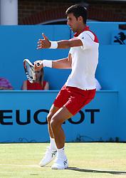 June 21, 2018 - London, United Kingdom - Novak Djokovic (SRB) in action.during Fever-Tree Championships 2nd Round match between Novak Djokovic (SRB) against Grigor Dimitrov (BUL) at The Queen's Club, London, on 21 June 2018  (Credit Image: © Kieran Galvin/NurPhoto via ZUMA Press)