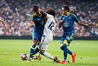 Real Madrid's player Marcelo and Celta de Vigo's player Facundo Roncaglia and Fabian Ariel Orellana during a match of La Liga Santander at Santiago Bernabeu Stadium in Madrid. August 27, Spain. 2016. (ALTERPHOTOS/BorjaB.Hojas)