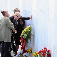 Family and friend of the victims of Flight 93 touches the name of First Officer, LeRoy Homer Jr. at the Wall of Names at the Flight 93 Memorial on the 15th anniversary of  the the crash of the flight on September 11, 2016.  Photo by Archie Carpenter/UPI
