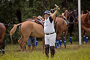 Nikolina Gora, Moscow Region, Russia, 25/06/2005..The Russian Polo Cup 2005, organised by the Russian Federation of Polo Players and the Moscow Polo Club. Players limber up before their matches.