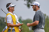 Jon Rahm (ESP) and caddie Adam Hayes chat after sinking his birdie putt on 1 during 1st round of the 100th PGA Championship at Bellerive Country Club, St. Louis, Missouri. 8/9/2018.<br /> Picture: Golffile | Ken Murray<br /> <br /> All photo usage must carry mandatory copyright credit (© Golffile | Ken Murray)