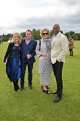 Left to right, BETH GODDARD, PHILLIP GLENISTER, FIONA HAWTHORNE and COLIN SALMON at the Audi Polo Challenge at Coworth Park, Blacknest Road, Ascot, Berkshire on 31st May 2015.